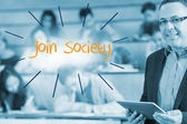 Join society against lecturer standing in front of his class in lecture hall — Stock Photo