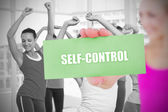 Fit blonde holding card saying self control — Stock Photo