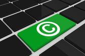Copyright symbol on key — Stock Photo