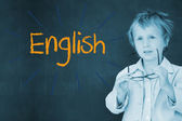 English against schoolboy and blackboard — Stock Photo