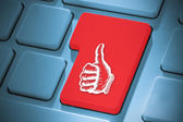 Composite image of thumbs up on enter key — Stock Photo