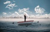Businessman looking away in a sailboat — Stock Photo