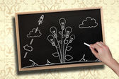 Hand drawing light bulb plant with chalk — Stock Photo