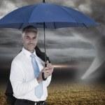Businessman holding blue umbrella — Stock Photo #44893973