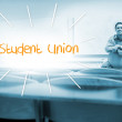Student union against lecturer sitting in lecture hall — Stock Photo #44898257