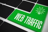 Web traffic on black keyboard — Stock Photo