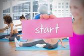 Woman holding pink card saying start — Stock Photo