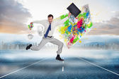 Jumping businessman with his suitcase — Stock Photo
