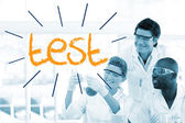 Test against scientists working in laboratory — Stock Photo