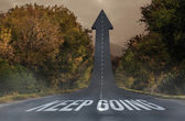 Keep going against road turning into arrow — Stock Photo
