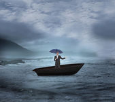 Businessman holding umbrella in a sailboat — Stock Photo