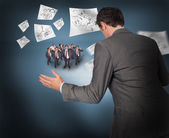Businessman with tiny businessmen — Stock Photo