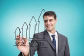 Businessman drawing graph — Stockfoto