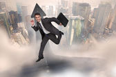 Cheerful businessman in a hurry — Stock Photo