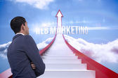Web marketing against red steps arrow pointing up against sky — Stock Photo