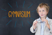 Gymnasium against schoolboy and blackboard — Stock Photo