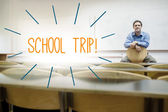 School trip! against lecturer sitting in lecture hall — Stock Photo