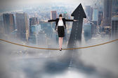 Businesswoman performing a balancing act — Stock Photo
