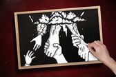 Hand drawing helping hands with chalk — Stock Photo
