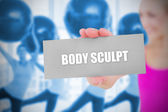 Fit blonde holding card saying body sculpt — Stock Photo