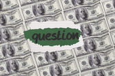 Question against digitally generated sheet of dollar bills — Stock Photo