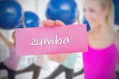 Woman holding pink card saying rumba — Stock Photo