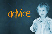 Advice against schoolboy and blackboard — Stock Photo