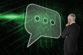 Speech bubble and businessman looking — Stock Photo