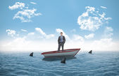 Thinking businessman in a sailboat — Stock Photo