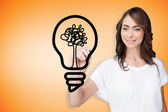 Businesswoman drawing light bulb — Stock Photo
