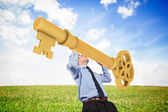 Иusinessman carrying large key — Stock Photo