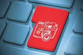 Composite image of camera on enter key — Stock Photo