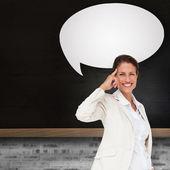 Businesswoman with speech bubble — Stock Photo