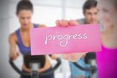 Woman holding pink card saying progress — Stock Photo
