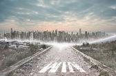 Win against stony path leading to large city on the horizon — Stock Photo