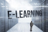 E-learning against server hallway in the blue sky — Stock Photo