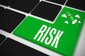 Risk on black keyboard — Stock Photo