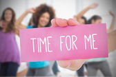Woman holding pink card saying time for me — Stock Photo
