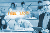 Evening classes against lecturer standing in front of his class in lecture hall — Stock Photo