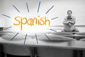 Spanish against lecturer sitting in lecture hall — Stock Photo