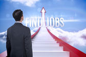 Find jobs against red steps arrow pointing up against sky — Stock Photo
