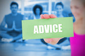 Fit blonde holding card saying advice — Stock Photo
