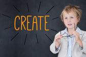 Create against schoolboy and blackboard — Stock Photo