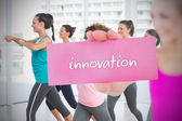 Woman holding pink card saying innovation — Stock Photo