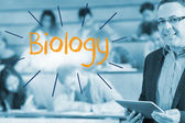 Biology against lecturer standing in front of his class in lecture hall — Stock Photo