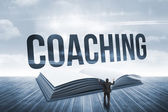 Coaching against open book against sky — Stock Photo