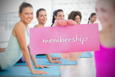 Woman holding pink card saying membership — Stock Photo
