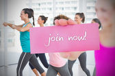 Woman holding pink card saying join now! — Stock Photo