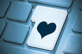 Composite image of heart on enter key — Stock Photo