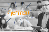 German against lecturer standing in front of his class in lecture hall — Stock Photo
